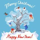 Дерево Snowy с подарками и bullfinches Стоковые Изображения RF