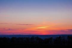Деревья солнца горизонта захода солнца осени Стоковые Изображения