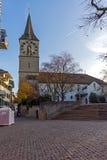 Деревья церков и осени St Peter, город Цюриха, Швейцарии Стоковая Фотография