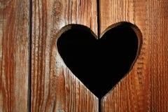 Деревянная дверь с сердцем Стоковое Изображение