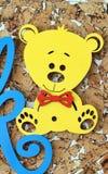 Деревянная желтая игрушка медведя Стоковое фото RF