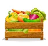 Деревянная коробка с овощами на белой предпосылке Стоковая Фотография