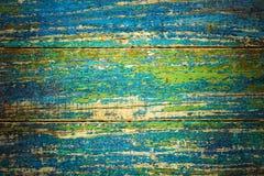 Деревянная краска голубого зеленого цвета предпосылки треснутая Стоковая Фотография