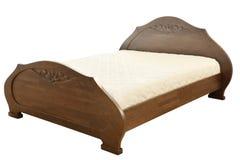 Кровать на белизне Стоковое Изображение RF