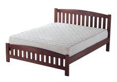 Деревянная кровать с тюфяком Стоковые Фото
