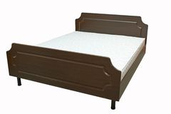 Деревянная кровать стоковое фото rf