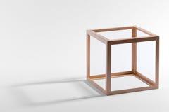 Деревянная кубическая рамка с тенью на белизне Стоковое Фото