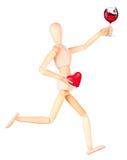 Деревянная кукла при шампанское держа красное сердце Стоковые Фото