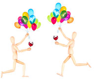Деревянная кукла с вином и воздушными шарами Стоковое Фото