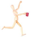 Деревянная кукла с красной чашкой кофе Стоковое Изображение