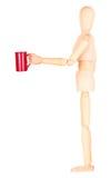 Деревянная кукла с красной чашкой кофе Стоковое фото RF