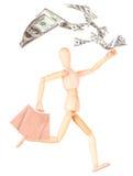 Деревянная кукла с хозяйственными сумками и деньгами Стоковые Изображения
