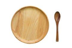 Деревянная ложка и деревянное блюдо плиты или деревянных на белой предпосылке Стоковое Изображение