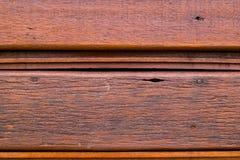 Деревянная предпосылка текстуры коричневого цвета планки Стоковое Фото