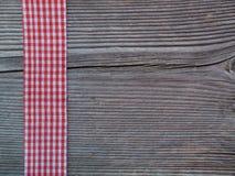 Деревянная предпосылка с проверенной лентой Стоковые Изображения