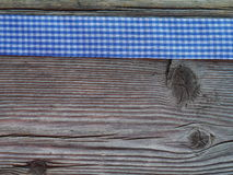 Деревянная предпосылка с проверенной лентой Стоковое Изображение RF