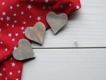 Деревянная предпосылка с сердцами Стоковая Фотография RF