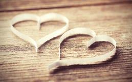 Деревянная предпосылка с сердцами Стоковое Фото