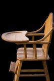 Деревянная предпосылка черноты высокого стульчика Стоковое Изображение