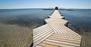 Деревянная пристань в меньшем море стоковая фотография