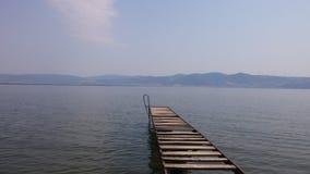 Деревянная пристань на реке Дунае Стоковое Изображение RF