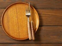 Деревянная пустая плита на деревянной предпосылке Стоковые Фото