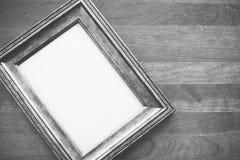 Деревянная рамка на деревянной предпосылке Стоковое фото RF