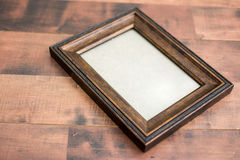 Деревянная рамка на деревянной предпосылке Стоковые Изображения