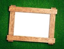 Деревянная рамка на зеленом цвете Стоковая Фотография