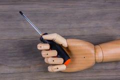 Деревянная рука держа отвертку Phillips Стоковая Фотография RF