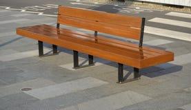 Деревянная скамья в городке Стоковые Изображения RF