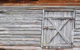Деревянная стена с дверью Стоковые Изображения