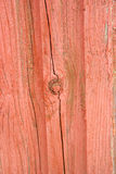 Деревянная структура с, котор слезли красной краской Стоковая Фотография