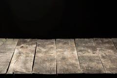 Деревянная таблица с черной предпосылкой Стоковые Фотографии RF