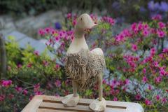 Деревянная утка с цветками Стоковое Изображение