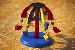 Деревянная цветастая игрушка Carousel Стоковые Изображения RF