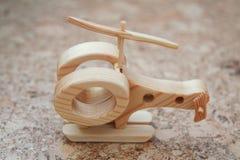 Деревянная handmade игрушка - вертолет самолета Стоковые Изображения