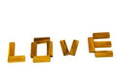 Деревянное ` ВЛЮБЛЕННОСТИ ` слов сделанное от естественных материальных писем Стоковое Изображение