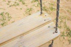 Деревянное качание в песке стоковое фото rf