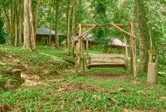 Деревянное качание в саде Стоковая Фотография