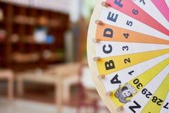 Деревянное колесо уча письма и номера Стоковые Изображения RF