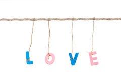 Деревянное слово влюбленности английского алфавита binded веревочкой Стоковое Изображение RF