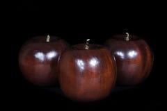 Деревянное яблоко Стоковые Изображения