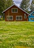 Деревянные коттеджи домов в древесинах Стоковое Изображение