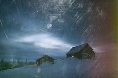 Деревянные дома в горах в зиме Стоковое Фото