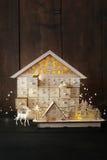 Деревянные дома праздника с светами Стоковое Изображение