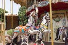 Деревянные лошади на французском carousel стоковое фото rf