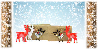 Деревянные олени и handmade подарки, состав рождества Стоковые Изображения
