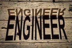 Деревянные письма строят инженера слова стоковые изображения