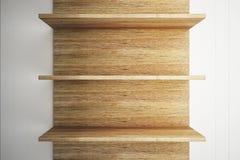 Деревянные полки на деревянной стене Стоковая Фотография